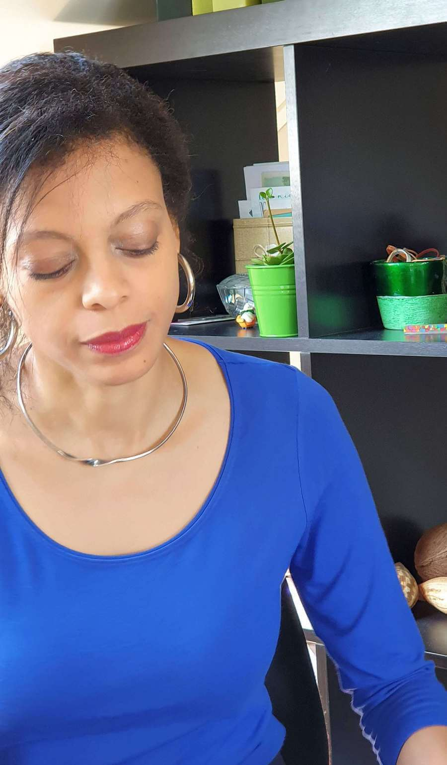 Tonia Dabwe wearing a blue top | Guide My Growth