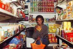 Woman in a small shop | Guide My Growth
