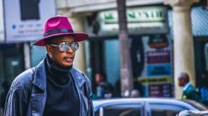 Man with a pink hat | Guide My Growth
