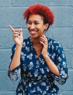 Woman smiling and pointing | Guide My Growth