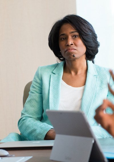 Woman in a meeting | Guide My Growth