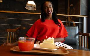 Woman with drink and pastry | Guide My Growth