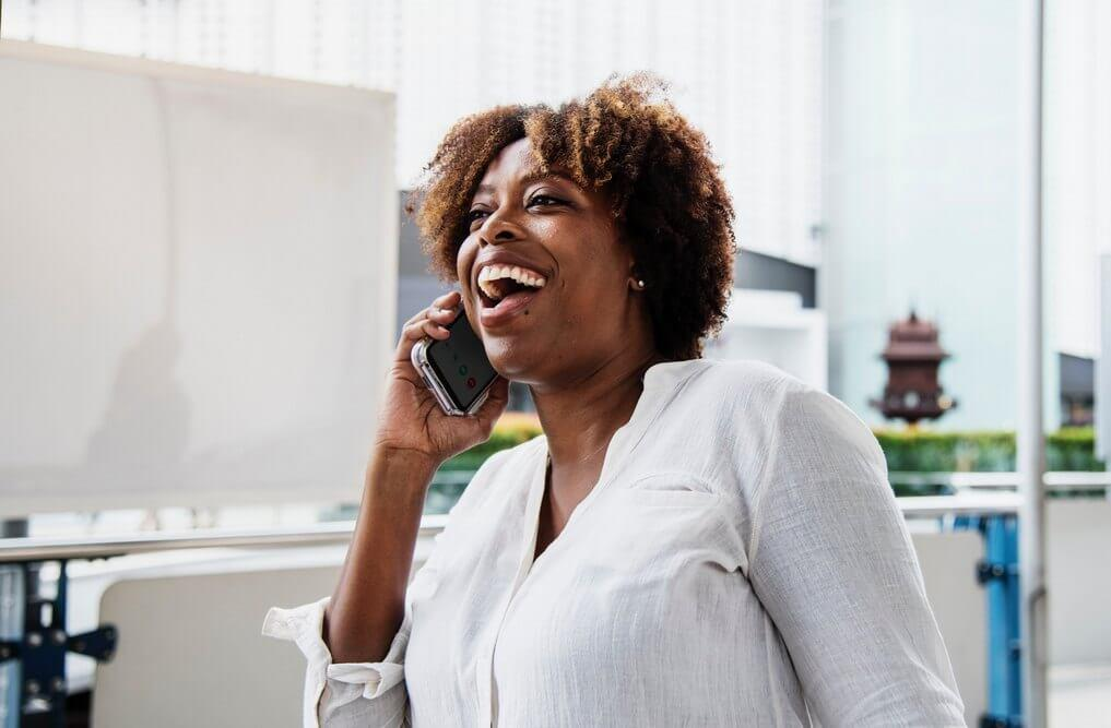 Laughing woman talking on phone   Guide My Growth