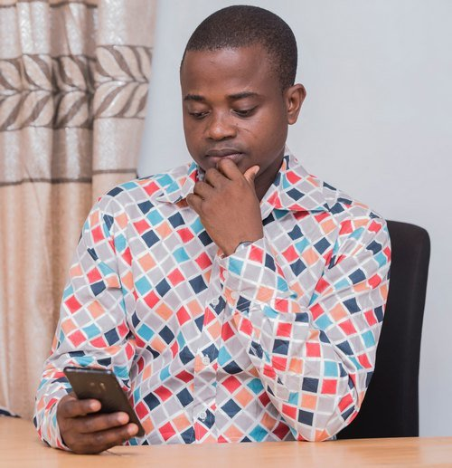 Man looking at phone | Guide My Growth