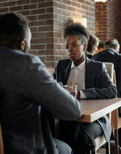 Business people at table | Guide My Growth