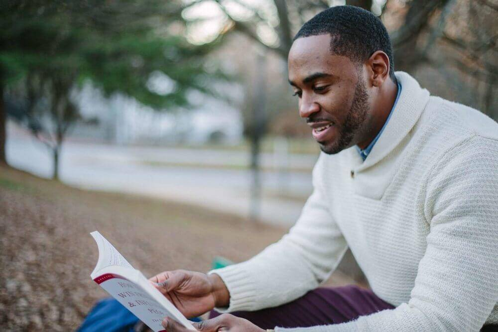 Man reading a book | Guide My Growth