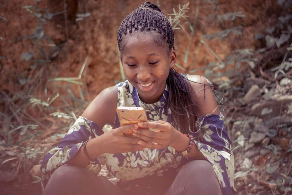 Woman with phone | Guide My Growth