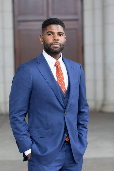 Man in a blue suit | Guide My Growth