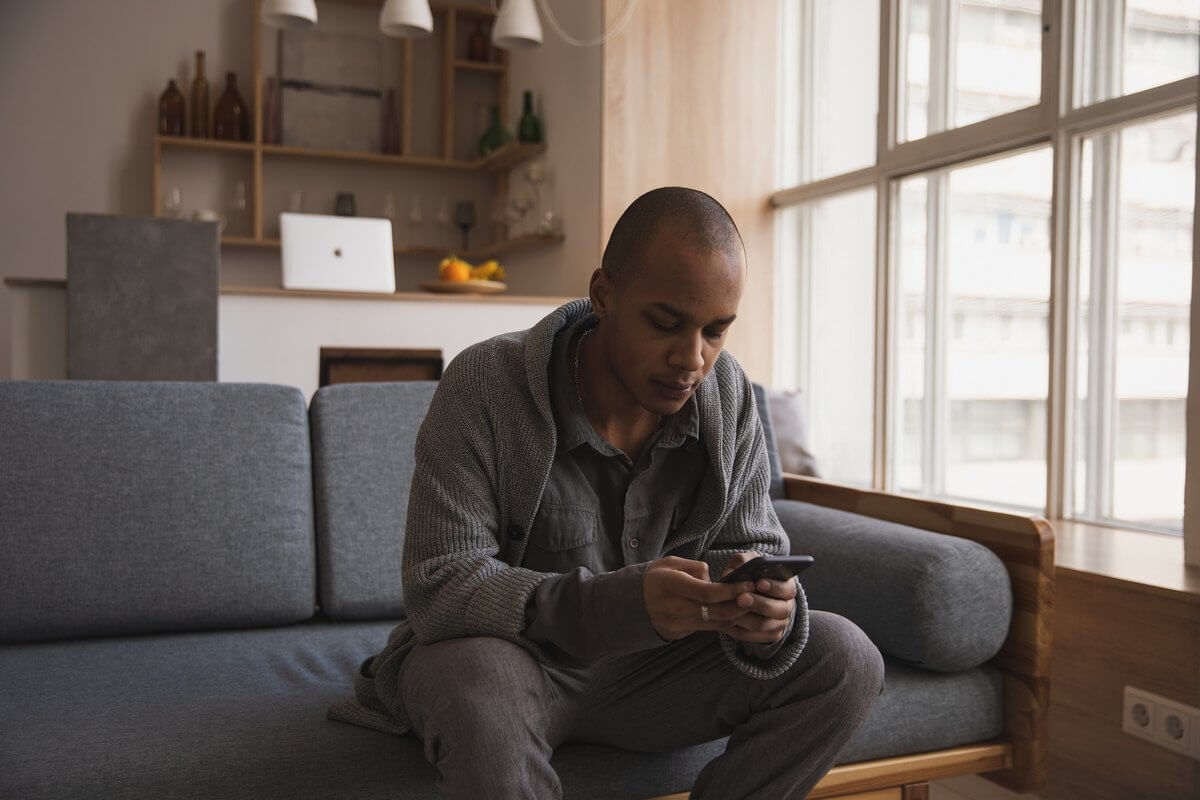 Young man with smartphone | Guide My Growth